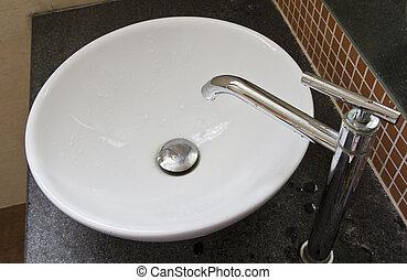 White basin. - White basin on a black marble