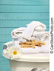 White basket with laundry - White laundry basket with folded...