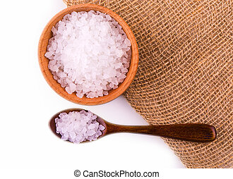 White bath salt in a wooden bowl with a wooden spoon