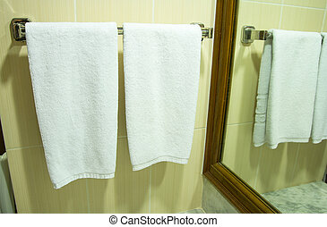 White bath towel hanging in the bathroom