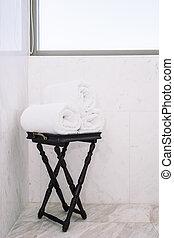 White bath towel on table