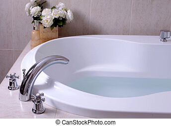 white bath tub with faucet and mozaic tiles