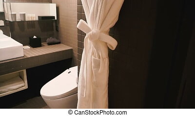 White bathrobe hanging in the bathroom