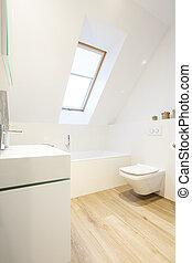 White bathroom with wooden floor