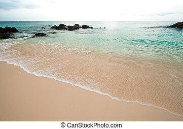 White beach with turquoise sea.