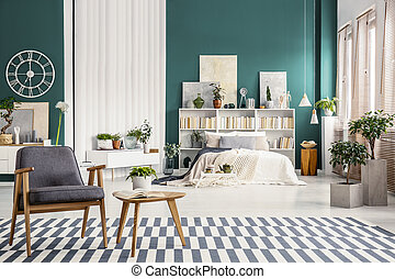 White bed against green wall