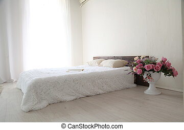 White bedroom bright interiors with bed
