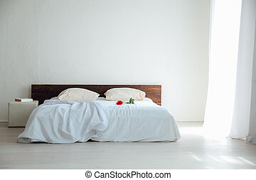 White bedroom bright interiors with bed and flowers