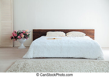 White bedroom bright interiors with bed decor