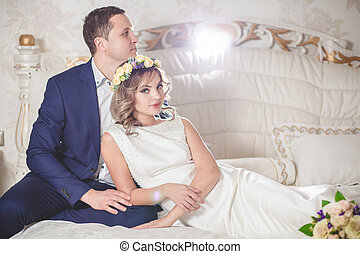white bedroom wedding groom