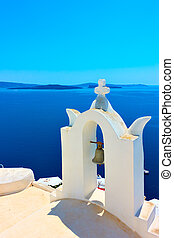 White belfry in Santorini - White belfry of greek orthodox...