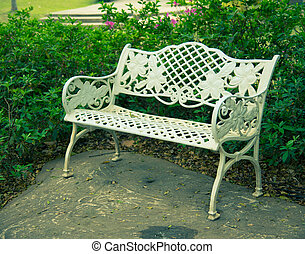 White bench in the garden ,vintage style
