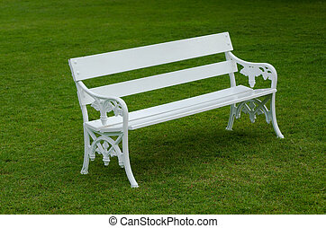 White Bench on green lawn