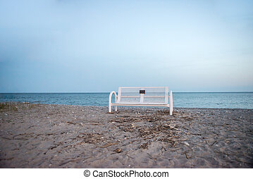 White Bench on Sand at Beach
