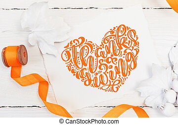 White berries, pumpkin, leaves and orange ribbon on a wooden mockup autumn background. Greeting card for Thanksgiving Day in rustic style with text Thanksgiving. Flat lay. Top view