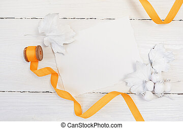 White berries, pumpkin, leaves and orange ribbon on a wooden mockup autumn background. Greeting card for Thanksgiving Day in rustic style with space for your text. Flat lay. Top view