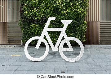 White bicycle sign on asphalt. Bike lane cycle on sidewalk.