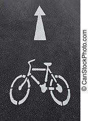 bicycle sign on asphalt bike lane