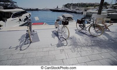 White bicycles on the quay near the water in Monaco in Monte...