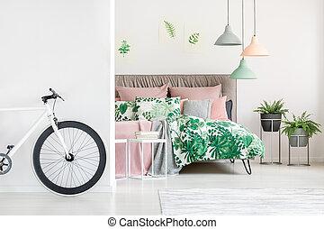 White bike in floral bedroom