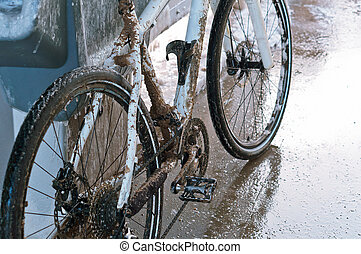 white bike is dirty with dirt