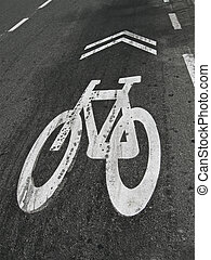white bike painted sign on grunge asphalt, healthy transportation security