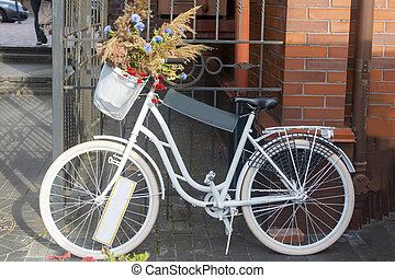 White bike with a blank sign for your text and advertising. Copy space, selective focus