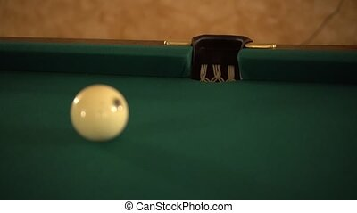 White billiard ball rolling in a pocket
