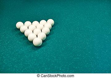 white billiard balls on a blue billiard table. gambling game of billiards