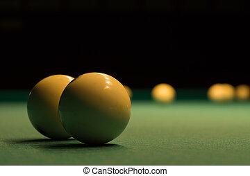 White Billiard Balls on Green Pool Table