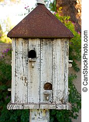 White Birdhouse with Rusted Roof
