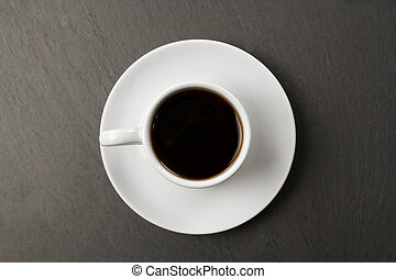 white black Cup of coffee on a black background.
