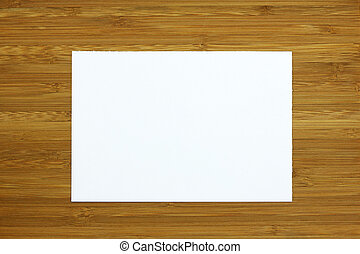 white blank card on wooden background