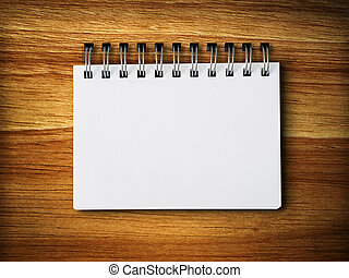 white blank note paper on rubber wood