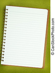 White Blank notebook on green background
