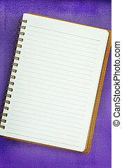 White Blank notebook on purple background