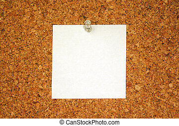 white blank paper for your text on cork background