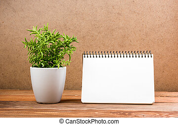 White blank paper notepad book at office worplace. Copy space