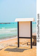 Blank sign on the beach