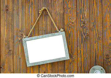white blank space board with rope on wooden door of a coffee shop, clipping path.