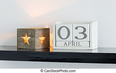 White block calendar present date 3 and month April