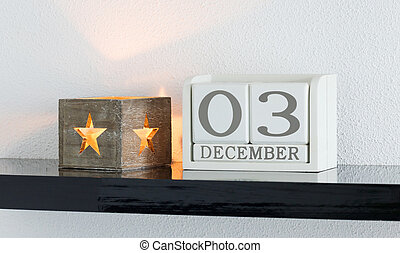 White block calendar present date 3 and month December