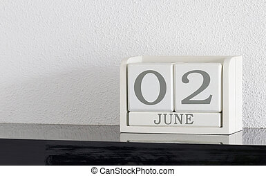 White block calendar present date 3 and month June