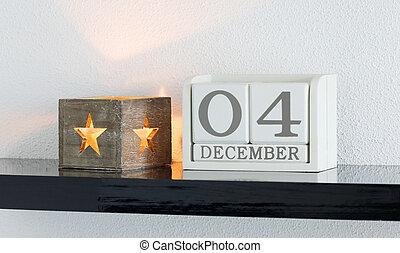 White block calendar present date 4 and month December