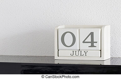 White block calendar present date 4 and month July