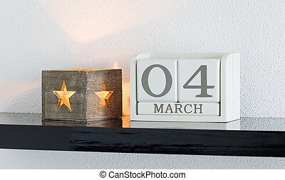 White block calendar present date 4 and month March