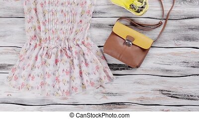 White blouse with colorful pattern. Blouse, flips flops and...
