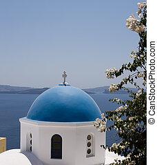 White-blue dome of the Orthodox church in Oia, Santorini, Greece