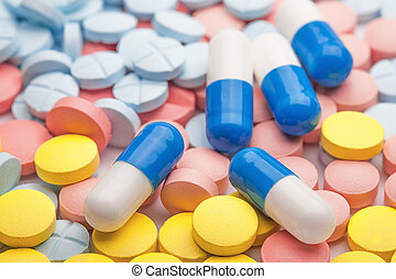 White-blue medical pills on the background of colored ...