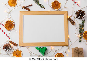 white board, garland and christmas decorations